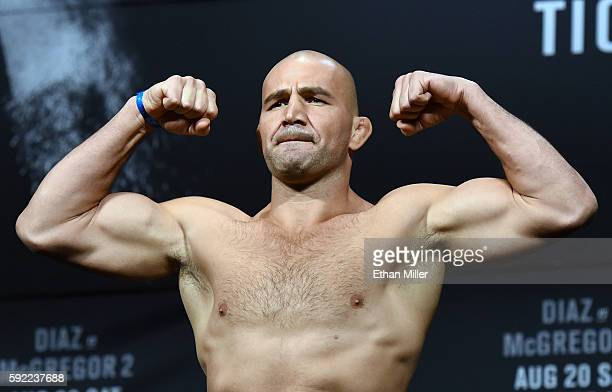 Mixed martial artist Glover Teixeira poses on the scale during his weighin for UFC 202 at MGM Grand Conference Center on August 19 2016 in Las Vegas...