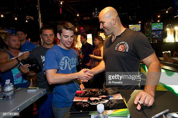 Mixed martial artist Glover Texeira interacts with a fan at the UFC Brazilian party during UFC International Fight Week inside the Rockhouse at The...