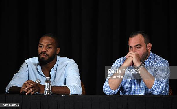 Mixed martial artist Jon Jones and his manager Malki Kawa take questions during a news conference at MGM Grand Hotel Casino to address Jones being...