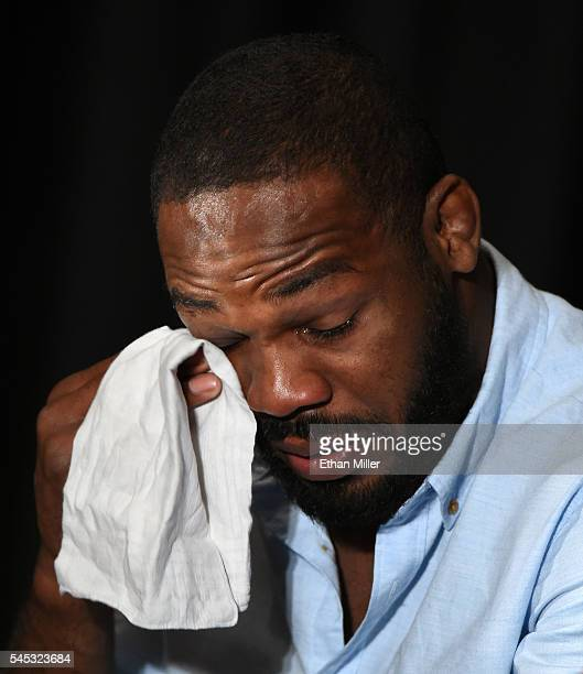 Mixed martial artist Jon Jones wipes away tears while speaking during a news conference at MGM Grand Hotel Casino to address being pulled from his...