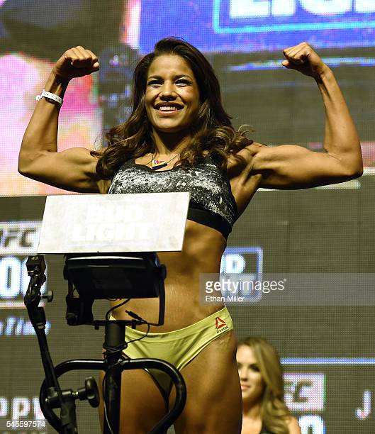 Mixed martial artist Julianna Pena poses on the scale during her weighin for UFC 200 at TMobile Arena on July 8 2016 in Las Vegas Nevada Pena will...