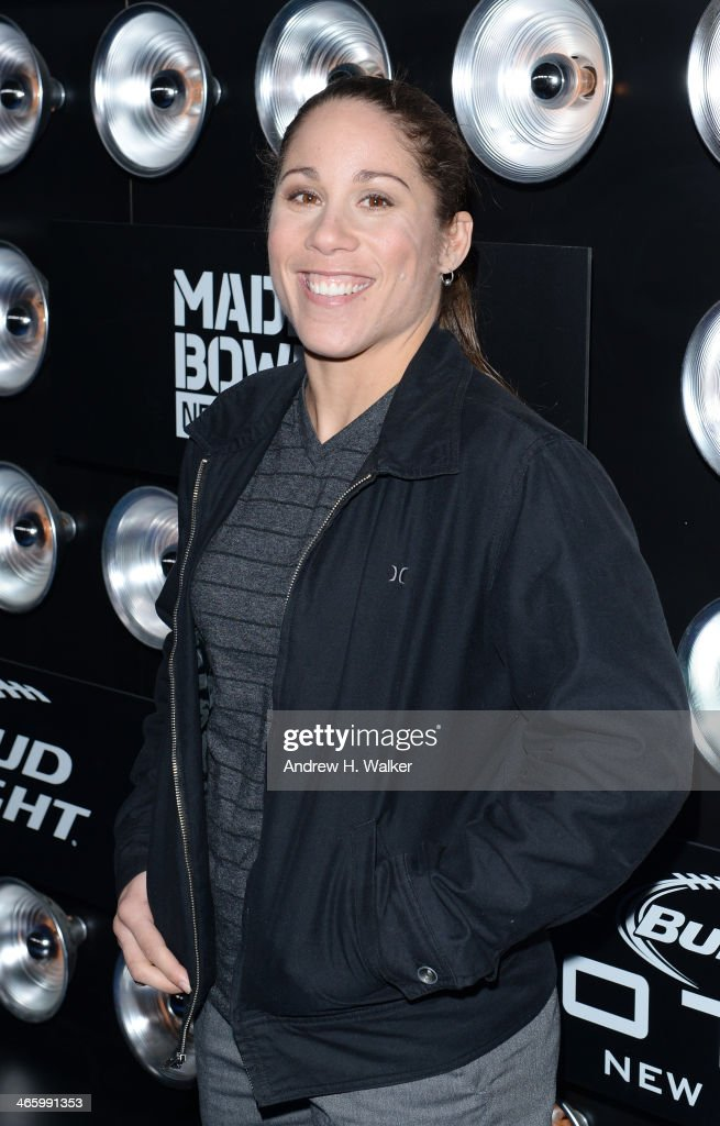 Mixed martial artist <a gi-track='captionPersonalityLinkClicked' href=/galleries/search?phrase=Liz+Carmouche&family=editorial&specificpeople=7139916 ng-click='$event.stopPropagation()'>Liz Carmouche</a> attends the Bud Light Madden Bowl at The Bud Light Hotel on January 30, 2014 in New York City.