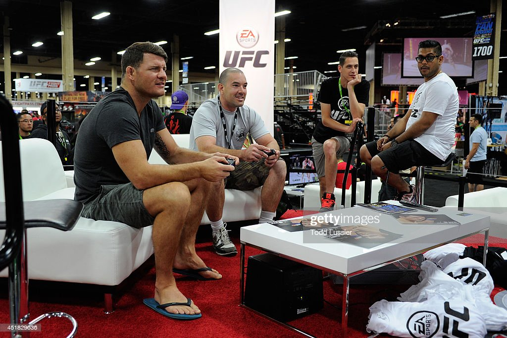 Mixed martial artist <a gi-track='captionPersonalityLinkClicked' href=/galleries/search?phrase=Michael+Bisping&family=editorial&specificpeople=4165714 ng-click='$event.stopPropagation()'>Michael Bisping</a> plays the new EA UFC video game with fans during the UFC Fan Expo 2014 during UFC International Fight Week at the Mandalay Bay Convention Center on July 6, 2014 in Las Vegas, Nevada.