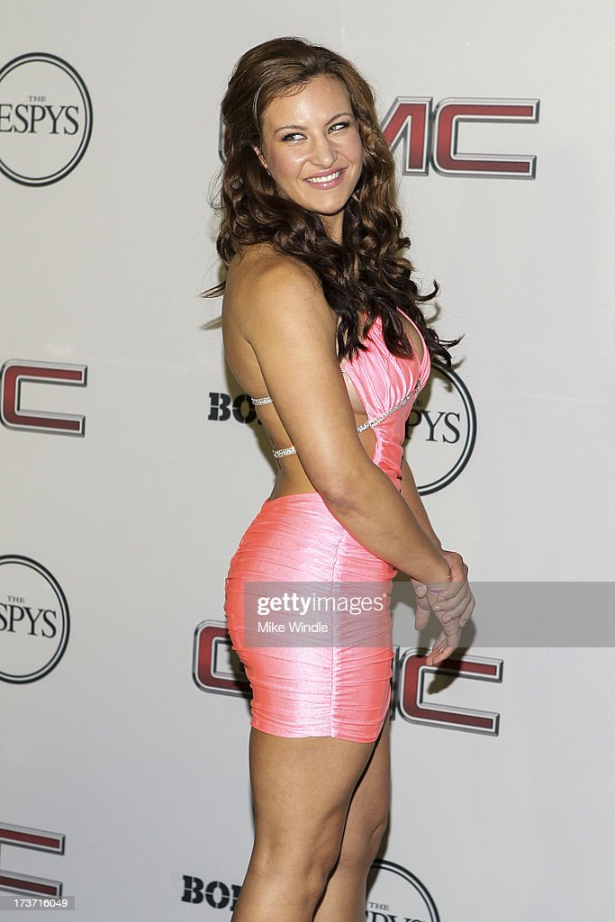 Mixed martial artist Miesha Tate arrives at ESPN the Magazine's 'Body Issue' 5th annual ESPY's event at Lure on July 16, 2013 in Hollywood, California.