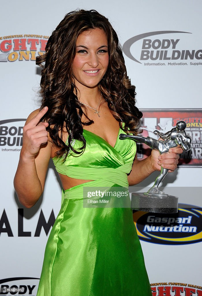 Mixed martial artist Miesha Tate holds the Female Fighter of the Year award at the Fighters Only World Mixed Martial Arts Awards 2011 at The Pearl concert theater at the Palms Casino Resort November 30, 2011 in Las Vegas, Nevada.