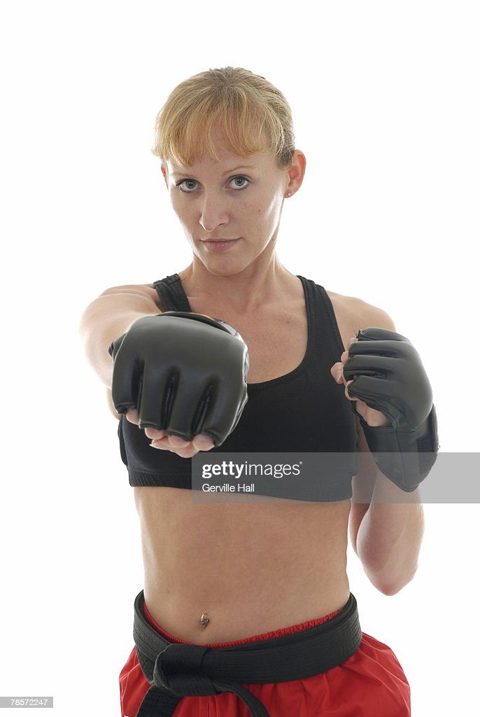 Mixed martial artist punching. : Stock Photo