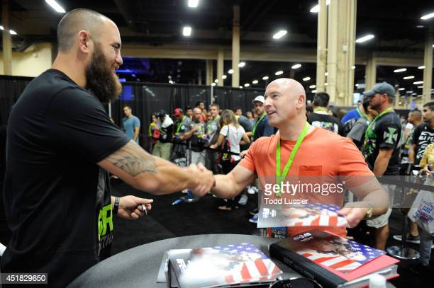 Mixed martial artist Travis Browne meets with fans during the UFC Fan Expo 2014 during UFC International Fight Week at the Mandalay Bay Convention...