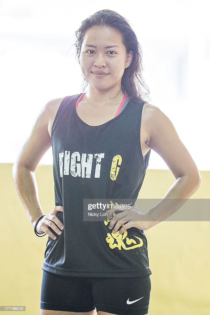 Mixed martial arts (MMA) fighter Sherilyn Lim poses for the media during a One Fighting Championship workout session at Fight G training centre on August 22, 2013 in Singapore.