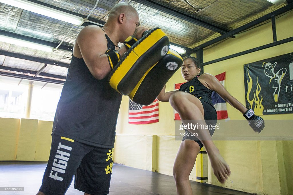 Mixed martial arts (MMA) fighter Sherilyn Lim trains during a One Fighting Championship workout session at Fight G training centre on August 22, 2013 in Singapore.