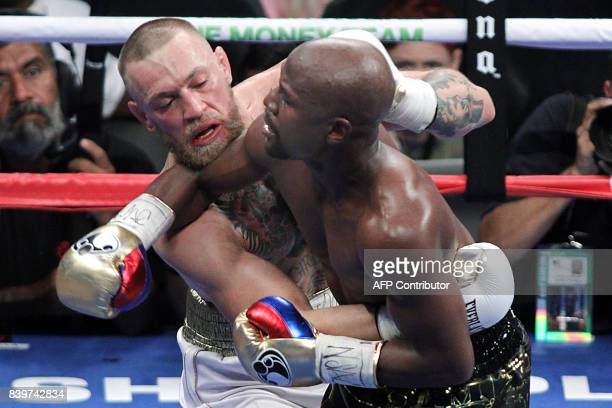 Mixed martial arts star Conor McGregor competes with boxer Floyd Mayweather Jr during their fight at the TMobile Arena in Las Vegas Nevada on August...
