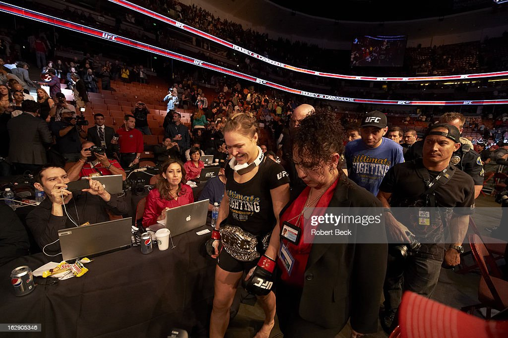 Ronda Rousey victorious with belt after winning Women's World Bantamweight Championship vs Liz Carmouche at Honda Center. This is the inaugural Women's UFC fight. Robert Beck F19 )