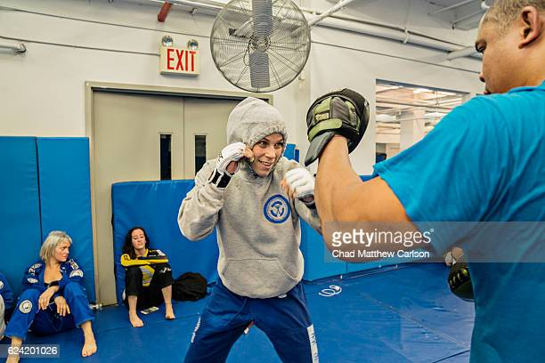 UFC 205 Preview Katlyn Chookagian during workout with her coach Jamal Patterson during training session photo shoot at Renzo Gracie Academy New York...