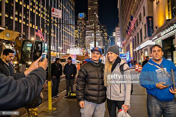 UFC 205 Preview Katlyn Chookagian posing with fan in street after weight cut outside Madison Square Garden New York NY CREDIT Chad Matthew Carlson