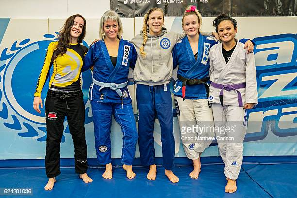 UFC 205 Preview Katlyn Chookagian posing with fellow fighters after workout during training session photo shoot at Renzo Gracie Academy New York NY...