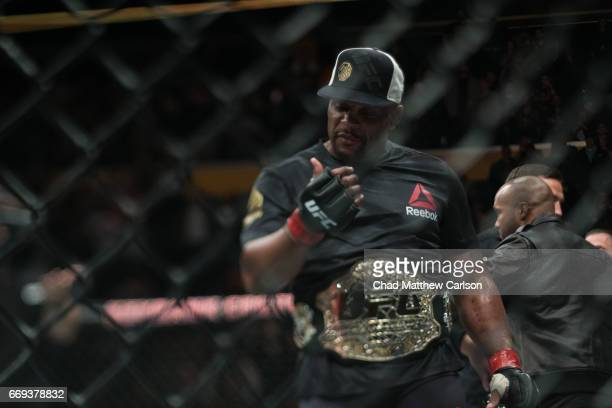 UFC 210 Daniel Cormier in ring with belt before Men's Light Heavyweight championship fight vs Anthony Johnson at KeyBank Center Cormier wins by...