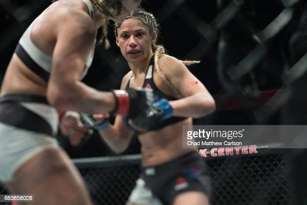 UFC 210 Pearl Gonzalez in action vs Cynthia Calvillo during Women's Strawweight class at KeyBank Center Calvillo defeated Gonzalez by submission at...