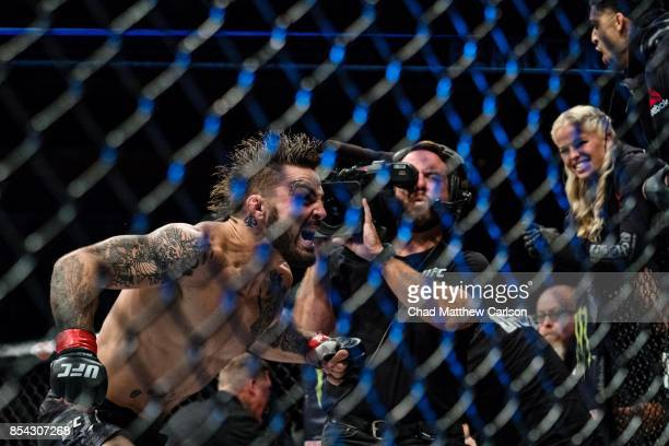 UFC Fight Night 116 Mike Perry victorious after defeating Alex Reyes during welterweight bout at PPG Paints Arena Pittsburgh PA CREDIT Chad Matthew...