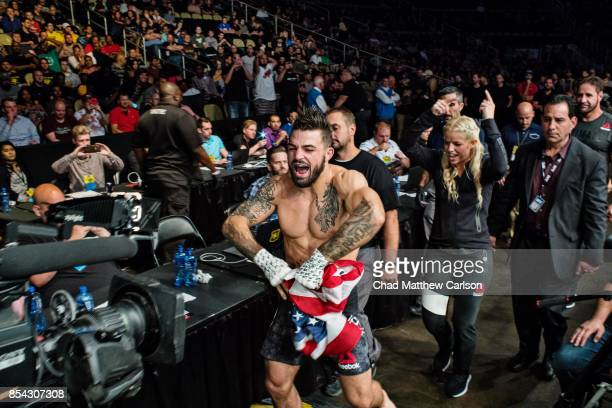 UFC Fight Night 116 Mike Perry victorious with US flag outside ring after defeating Alex Reyes during welterweight bout at PPG Paints Arena...