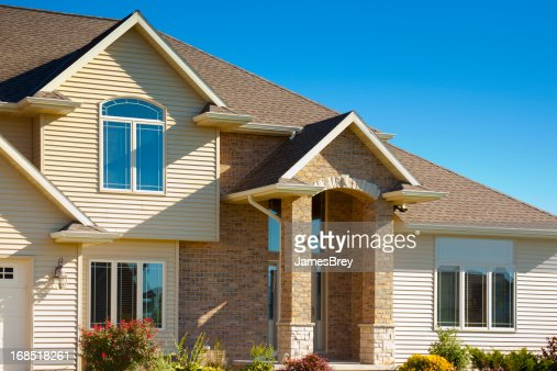 Mixed materials house with stone brick vinyl siding stock for Mixing brick and stone exterior
