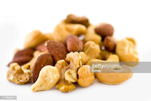 Mixed nuts close up on white background