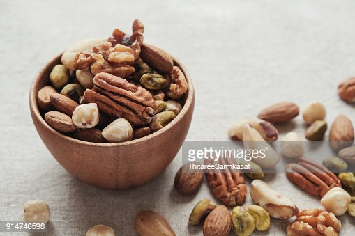 mixed nuts in wooden bowl, healthy fat and protein food and snack, ketogenic diet food : Stock Photo
