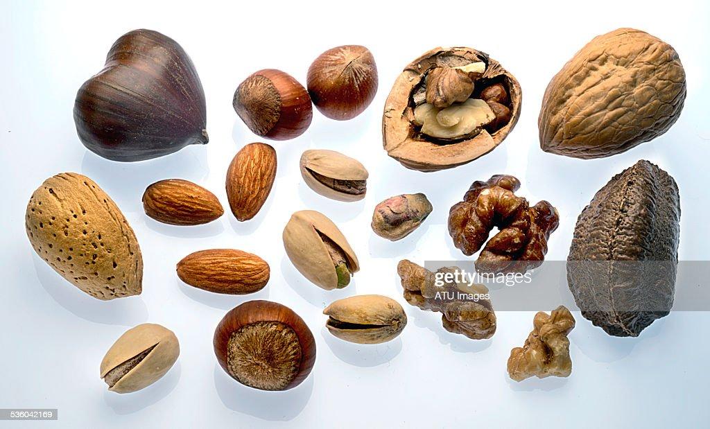 Mixed nuts on light box : Stock-Foto