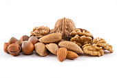 Whole, and cracked nut family on white background.