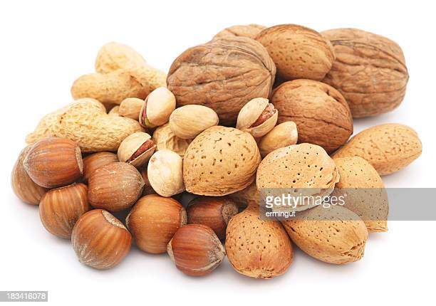 Mixed nuts pile isolated on white