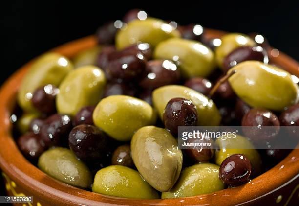 Mixed olives on black background