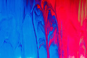 Mixed paint background, flowing down from the colored drops