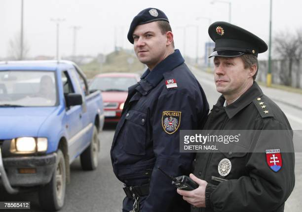 A mixed police unit from Austria and Slovakia stands 19 December 2007 in Jarovce near Bratislava days before Slovakia becomes a member of the...
