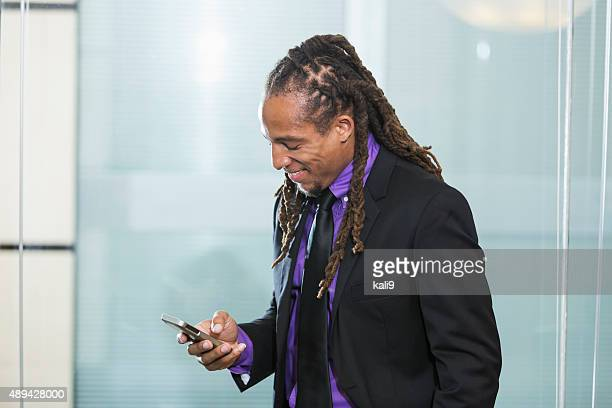 Mixed race African American businessman with smartphone