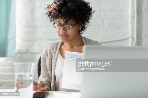 Mixed race architect working at desk