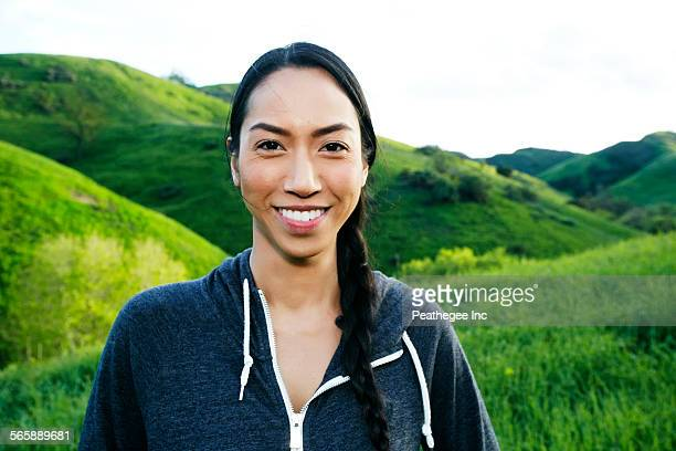 Mixed race athlete standing on rural hillside