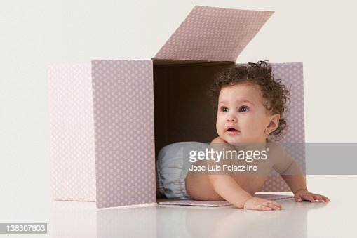 Mixed race baby girl laying in box : Stock Photo