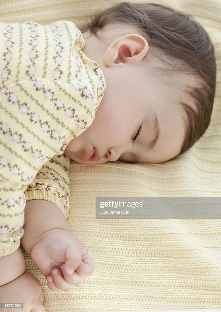 Mixed race baby girl sleeping : Stock Photo