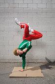 Mixed race boy breakdancing