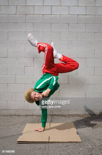 Mixed race boy breakdancing