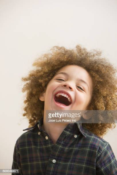 Mixed race boy laughing