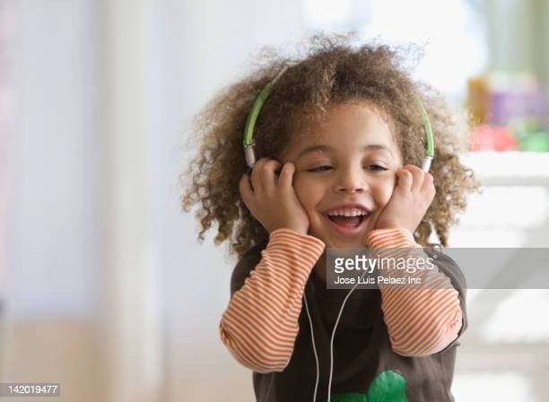 Mixed race boy listening to headphones