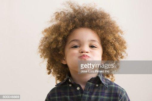 Mixed race boy making a face