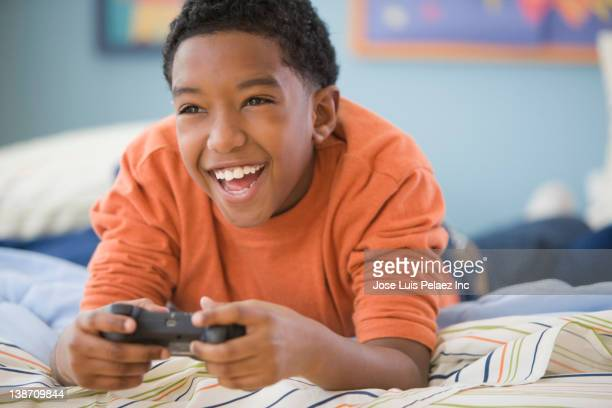 Mixed race boy playing video game