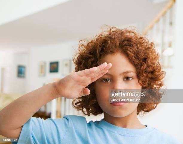 Mixed Race boy saluting