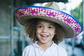 Mixed race boy wearing sombrero