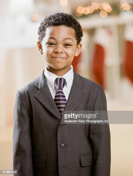 Mixed Race boy wearing suit