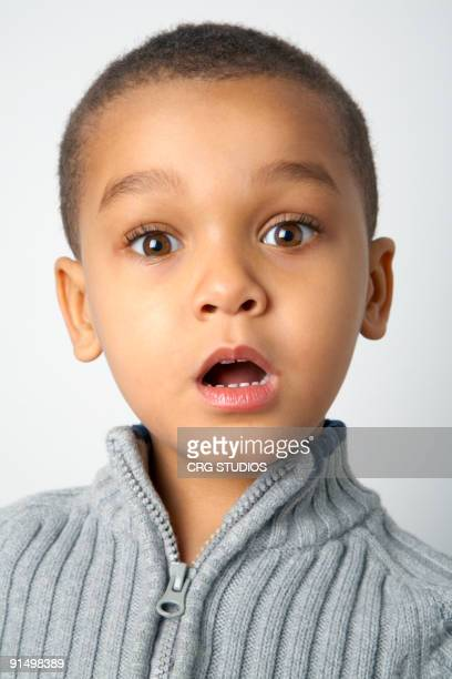 Mixed race boy with surprised expression