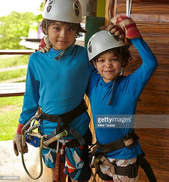 Mixed race boys preparing to zip line
