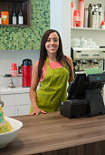 Mixed race business owner standing in shop
