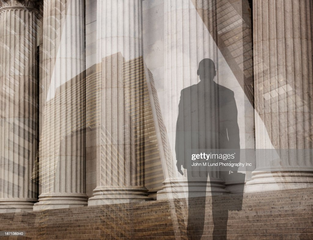 Mixed race businessman admiring pillars