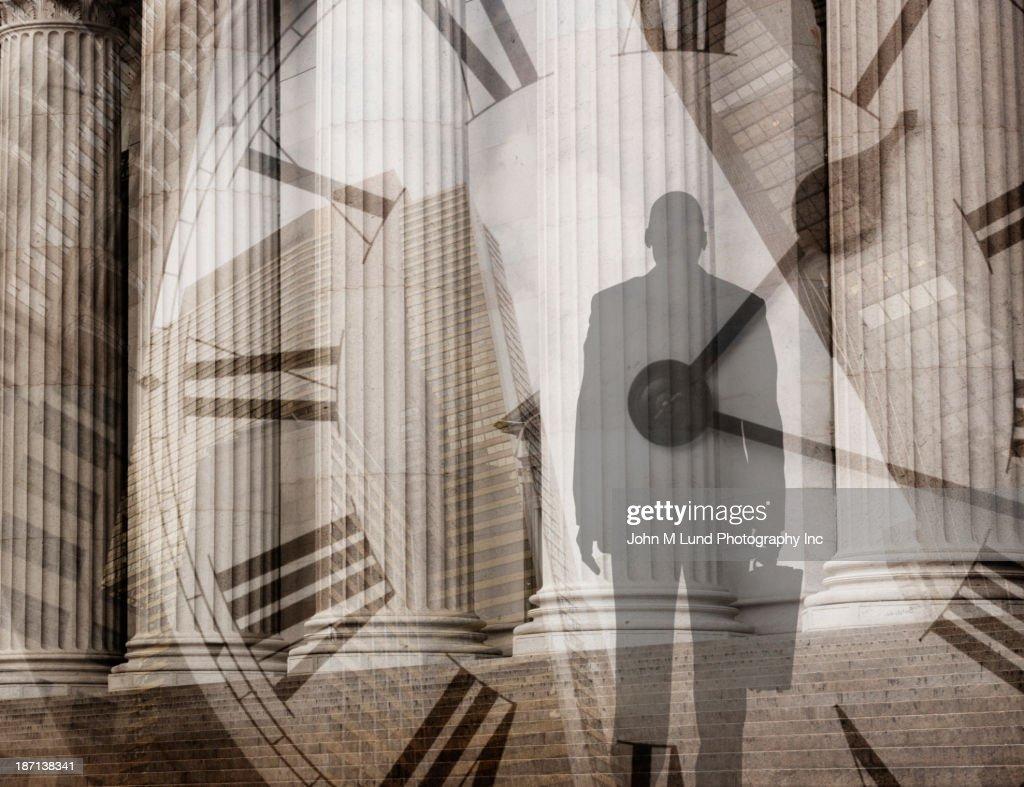 Mixed race businessman admiring pillars : Stock Photo